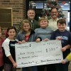 Modern Woodmen of America presents check to Rush Strong School