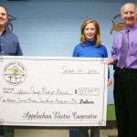 Jefferson County School System's Director of Facilities Michael Phagan and School Board Chair Anne Marie Potts were pleased to accept an incentive check from Appalachian Electric Cooperative General Manager Greg Williams in recognition of recent lighting upgrades at the County's elementary and middle schools.