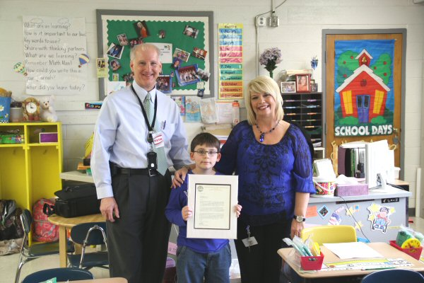 L-R / Appalachian Electric Cooperative General Manager Greg Williams, Seth Runyon 2nd Grade Talbott Elementary, and Talbott 2nd Grade Teacher Peggy Conway