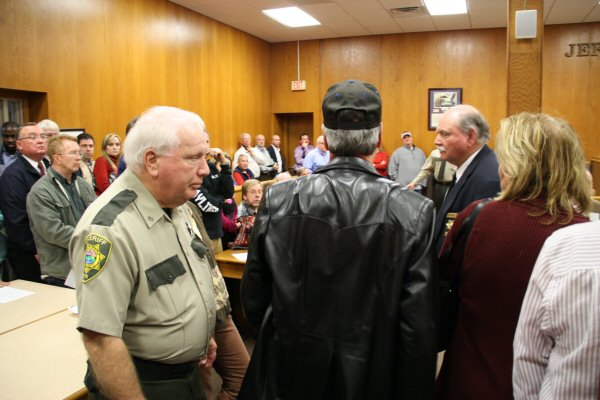 Citizen being removed from the courtroom by the order of Commission Chairman Monday Night - Staff Photo by Jeff Depew