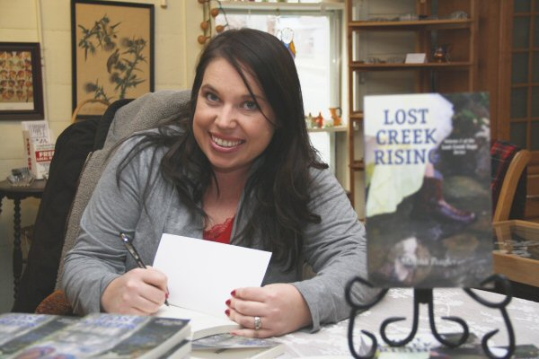 Lost Creek Rising Author Melissa Peagler signing her latest book Saturday at Rachel's Attic Antiques in Dandridge, Tennessee - Staff Photo by Jeff Depew
