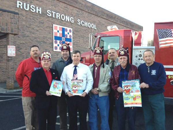 Back Row (L-R) - Captain Sammy Solomon, Lee Rayburn of Shriners, School Resource Officer and Ass't Chief Maurice Solomon / Front Row (L-R) Bill Gentry Potentate of Kerbela Shriner, Principal Chris Vineyard, Greg France of the Shriners, AC Carr of Shriners and Fire Chief Frank Solomon