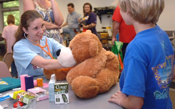A veterinary student examines a teddy bear during a Open House at the UT College of Veterinary Medicine. This year's event is scheduled for Saturday, April 20, and is free and open to the public.