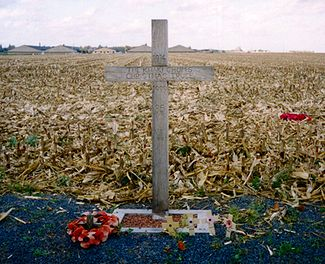 "A cross, left in Saint-Yves (Saint-Yvon - Ploegsteert; Comines-Warneton in Belgium) in 1999, to commemorate the site of the Christmas Truce. The text reads:""1914 – The Khaki Chum's Christmas Truce – 1999 – 85 Years – Lest We Forget"