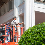 A crew paints the columns of historic Sarah  Swann Hall on the campus of Carson-Newman University. Constructed in 1904  Swann Hall was one of some 35 campus projects this summer that included  renovations to the University's library and Appalachian Center.