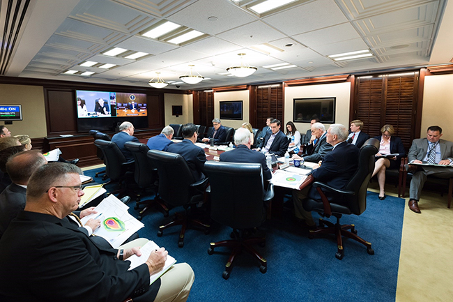 "President Donald J. Trump is seen on screen in the White House Situation Room, as he conducts a video teleconference regarding an update on Hurricane Harvey, Saturday, August 26, 2017, from a conference room at Camp David, near Thurmont, MD., conferring with Vice President Mike Pence; Chief of Staff Gen. John Kelly; Thomas Bossert, Homeland Security Advisor; Gen. Keith Kellogg, National Security Advisor Chief of Staff; Deputy Chief of Staff for White House Operations, Joe Hagin; Elaine Duke, Acting Secretary of the Department of Homeland Security; Health and Human Service Secretary Tom Price; U.S. Secretary of Energy Rick Perry; White House Deputy Chief of Staff Kirstjen Nielsen and William B. ""Brock"" Long, Administrator of FEMA. Also in the room and on the call were additional Cabinet members and White House Senior Staff. (Official White House Photo by Andrea Hanks)​"