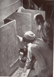 Howard Carter (kneeling), an Egyptian workman, and Arthur Callender at doors of burial shrines in Pharao Tutankhamen's tomb.November 25 or 27, 1922