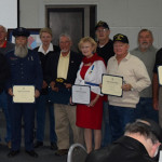 Vietnam era veterans who received lapel pins and certificates to recognize their service include: (left to right) Sam Newman, Pat Patrick, Roger Jenkins, Willa Holtzclaw, Jack Kramer, Pat Whaley for her brother Robert Finchum, David Hess, Keith LaVoie, Dan Hinds, and Jimi Duke.