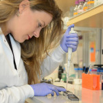 Researcher Sophie Zaaijer uses the MinION, a portable DNA sequencer, to get a quick genetic readout of a sample of cells.New York Genome Center