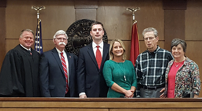 Pictured left to right is Circuit Court Judge Duane Slone, District Attorney General James B. Dunn, Assistant District Attorney Brett Bell and his wife April Bell and his parents Bruce and Martha Bell.